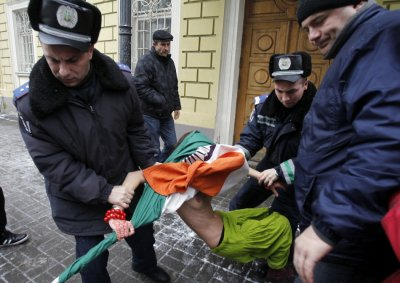 Another activist from Femen is detained by police during the protest, held in temperatures of -5C