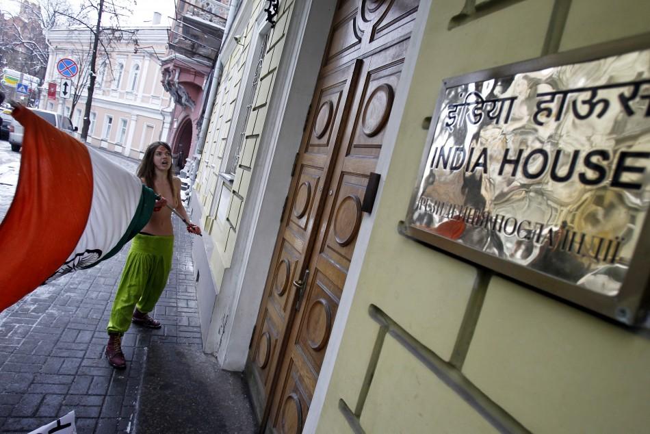 A member of the Ukrainian women's group Femen appears semi-naked outside the residence of the Indian ambassador in Kiev