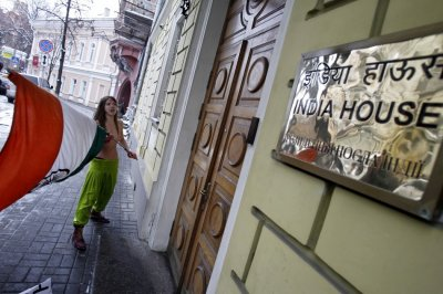 A member of the Ukrainian womens group Femen appears semi-naked outside the residence of the Indian ambassador in Kiev