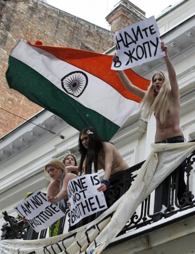 Activists from Femen bared their breasts and occupied the second floor of the building in Kiev