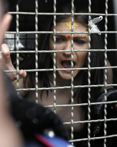Another member of Femen is detained by police following the protest in Kiev