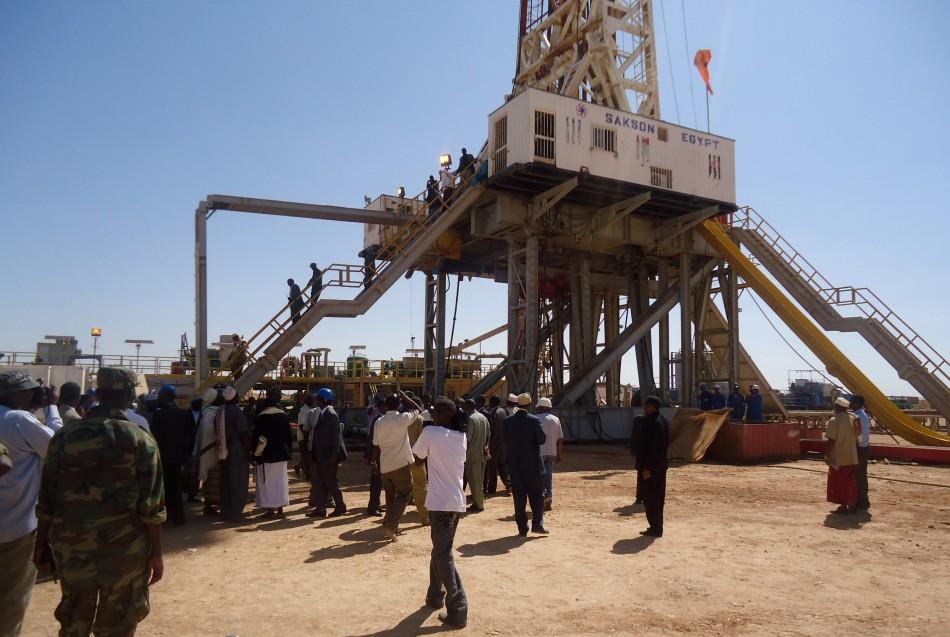 Engineers and visitors explore an exploratory well near Dharoor town in Puntland