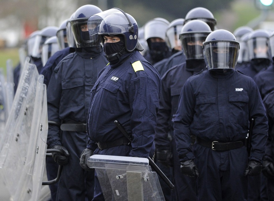 A police riot squad arrives at the low security Ford Open Prison in Arundel, southern England