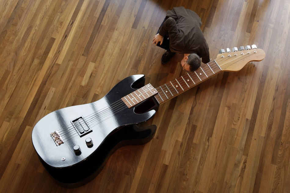 A guitar-shaped coffin