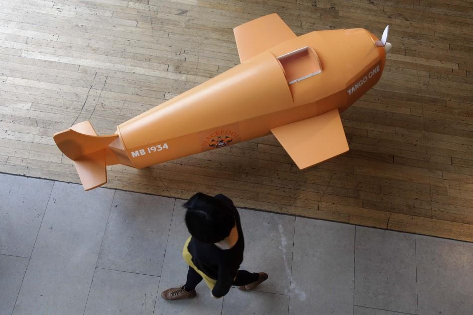 A coffin shaped like a plane