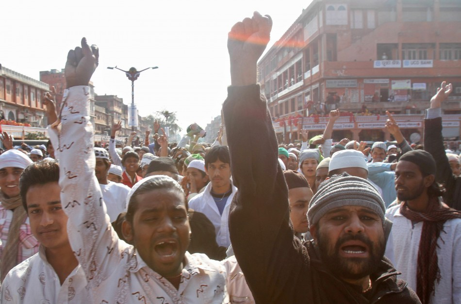 Muslims shout slogans against author Salman Rushdie, after offering their Friday prayers in Jaipur