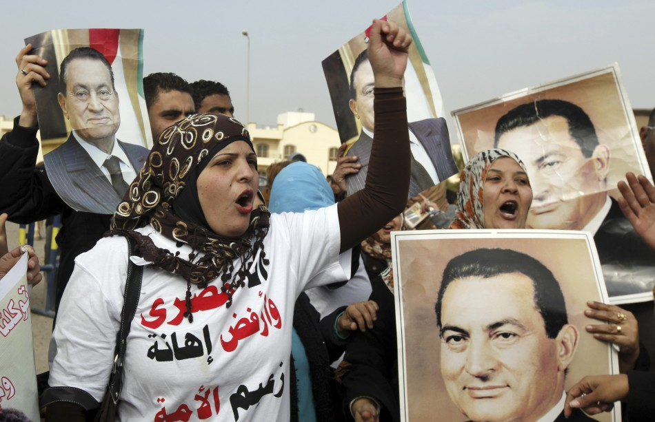 Supporters of Egypt's former President Hosni Mubarak shout slogans outside the police academy in Cairo