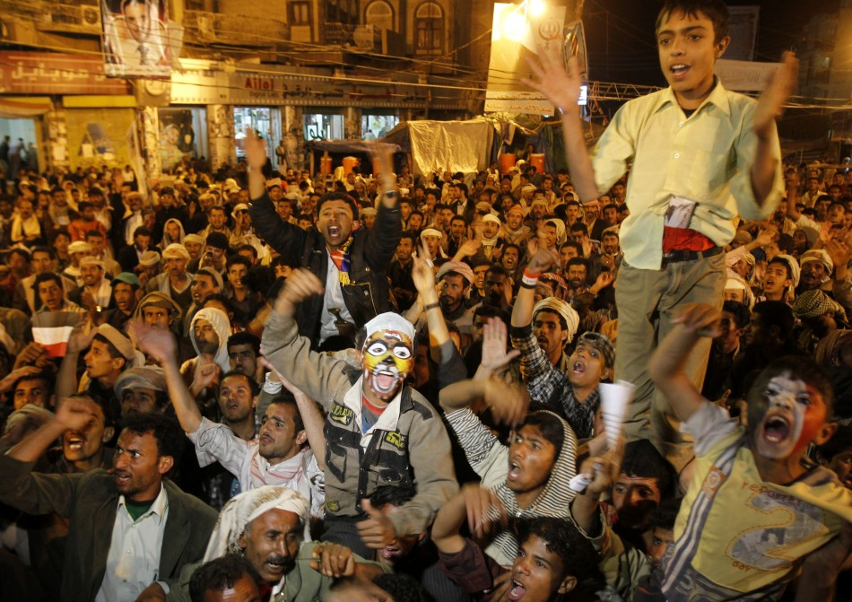 Anti-government protesters shout slogans in Sanaa