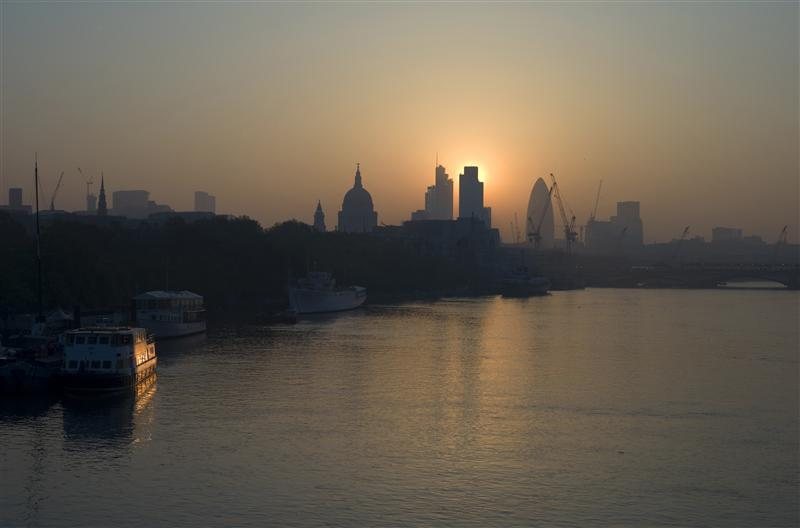 The sun rises above the financial district of the City of London