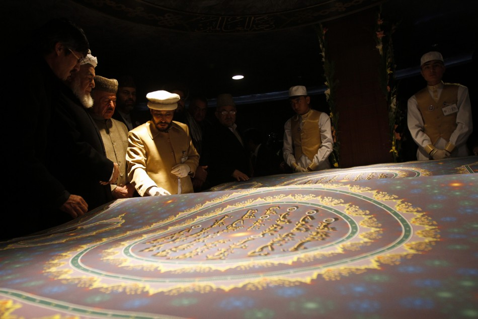 Calligrapher Mohammad Sabir Khedri with the largest Koran in the world