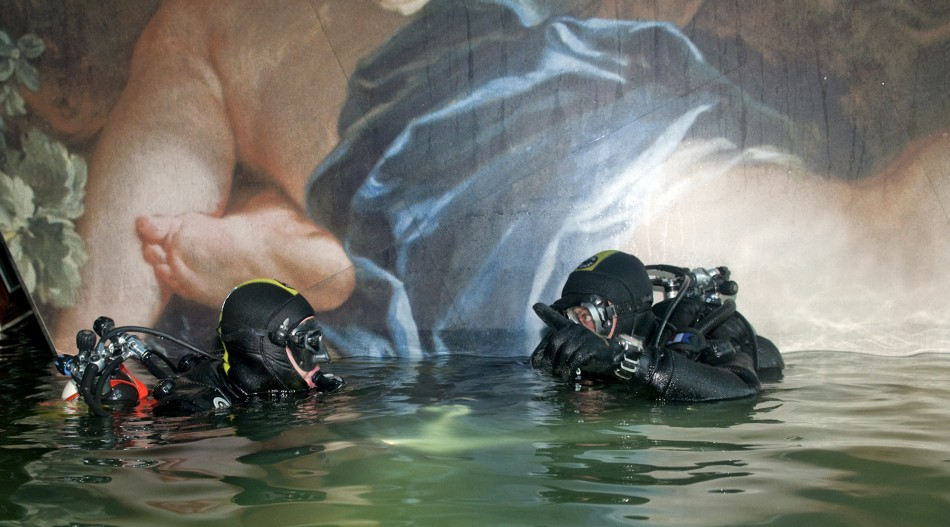 Two scuba divers of Italian Navy inspect inside the Costa Concordia cruise ship