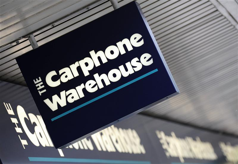 A Carphone Warehouse sign hangs outside a branch in west London