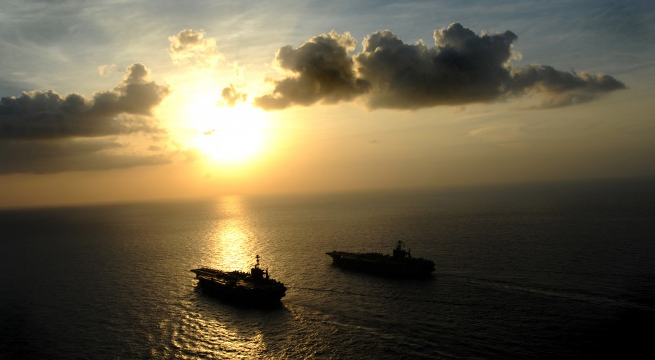 U.S. Navy handout photo of the USS Abraham Lincoln and the USS John C. Stennis