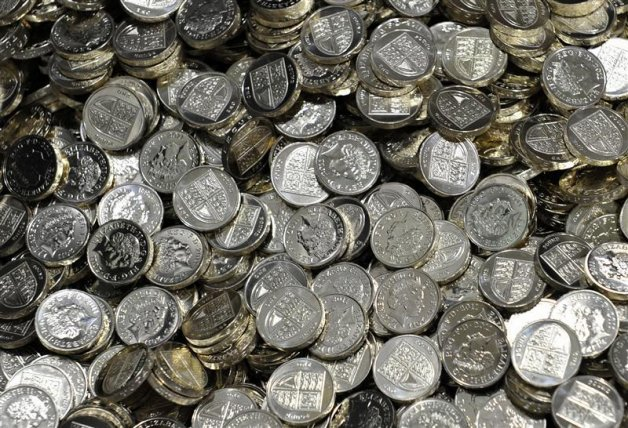 Newly minted one pound coins are seen at the Royal Mint in Cardiff