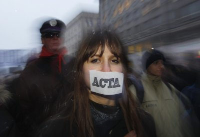 Demonstrators protest against Polands government plans to sign Acta