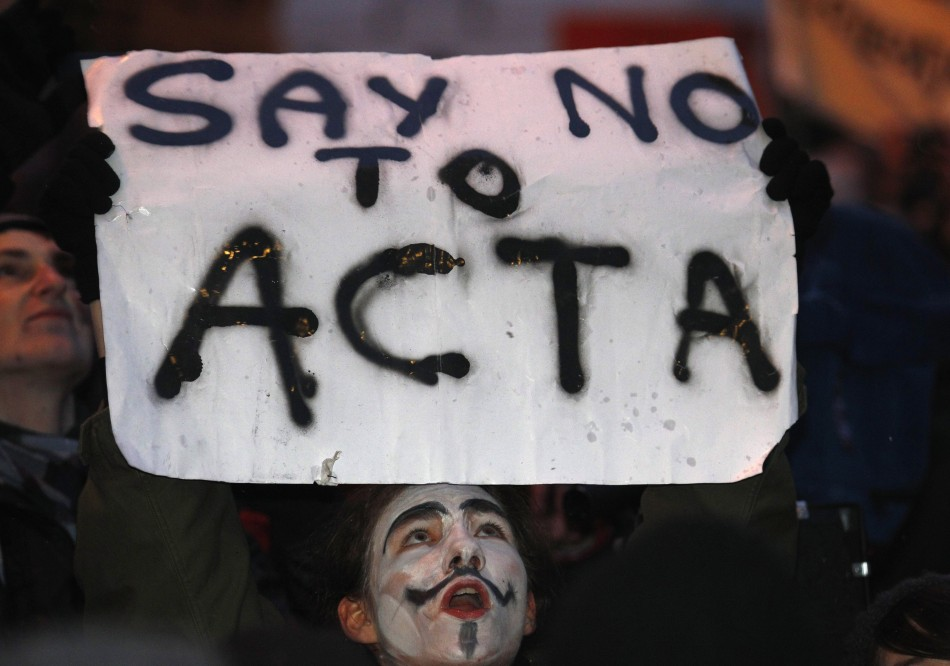 Demonstrators protest against Poland's government plans to sign Acta