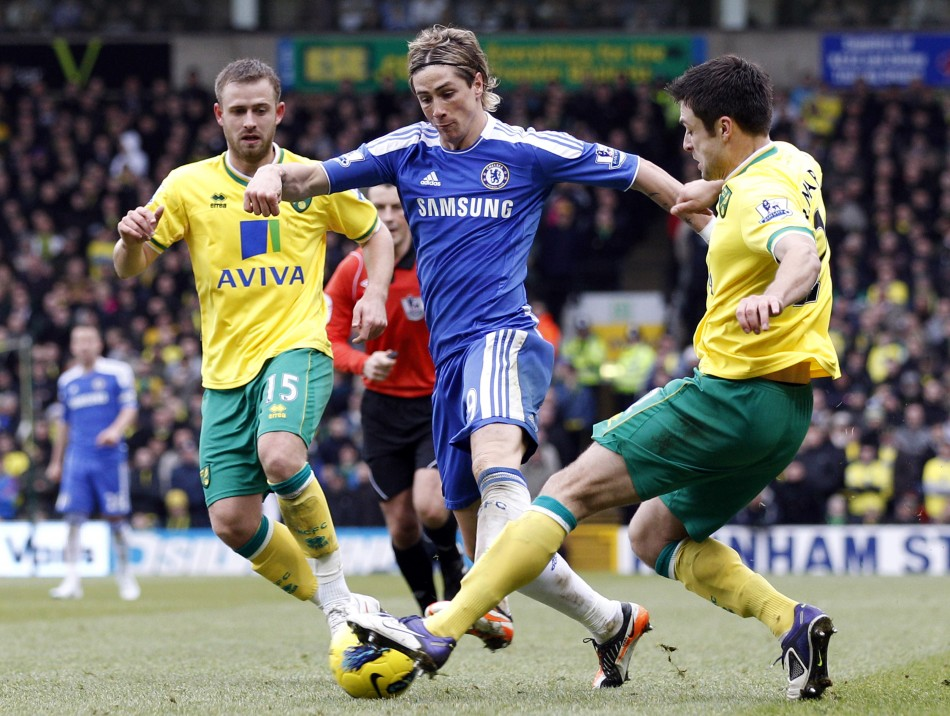 Norwich City's Fox and Martin challenge Chelsea's Torres during their English Premier League soccer match in Norwich