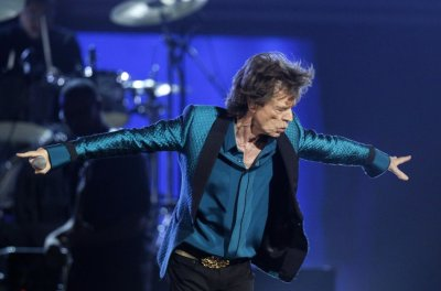 Mick Jagger bows after performing