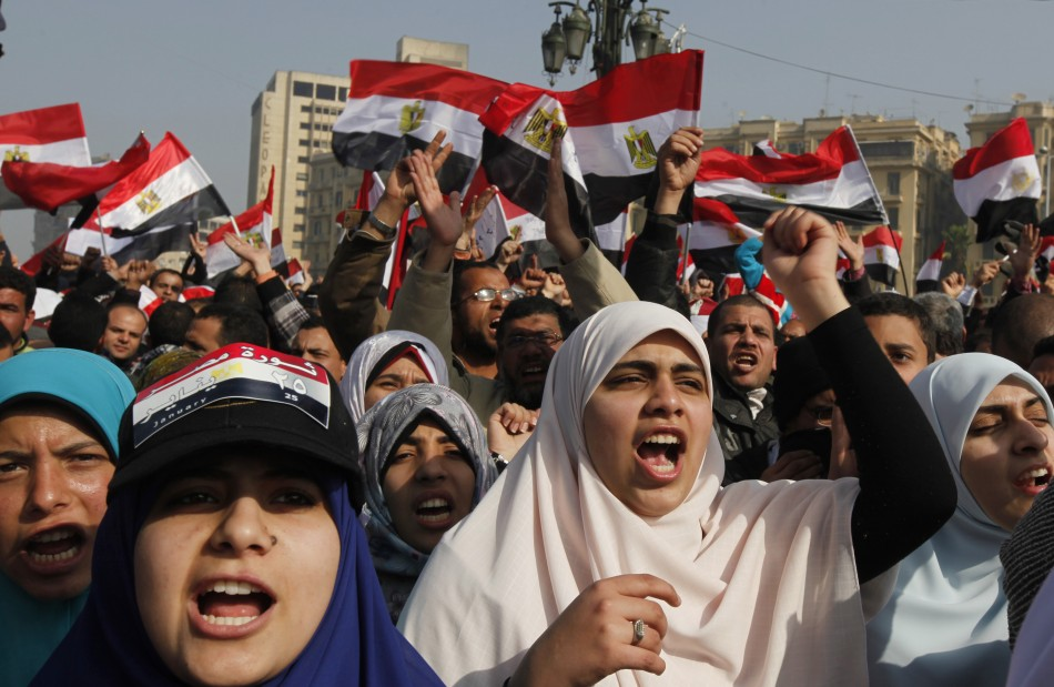 Demonstrators take part in a protest marking the first anniversary of Egypts uprising at Tahrir Square in Cairo