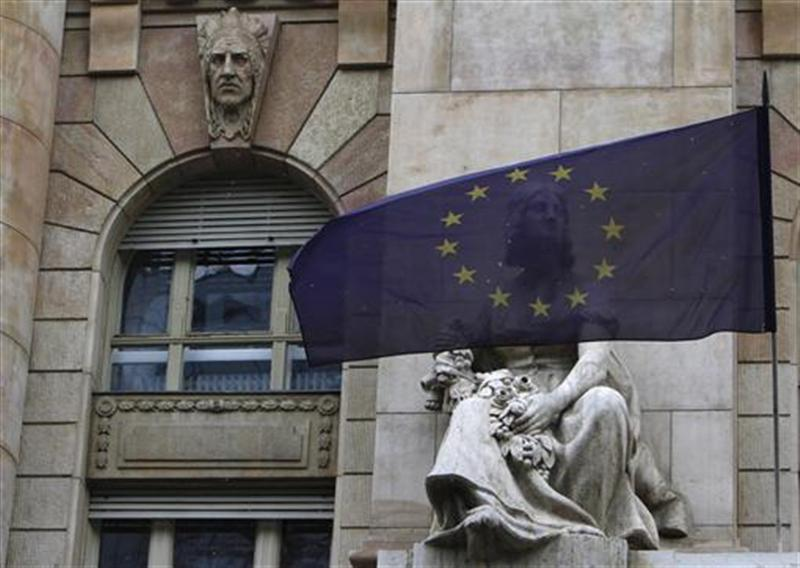 An EU flag flies on the frontage of the National Bank of Hungary building in Budapest