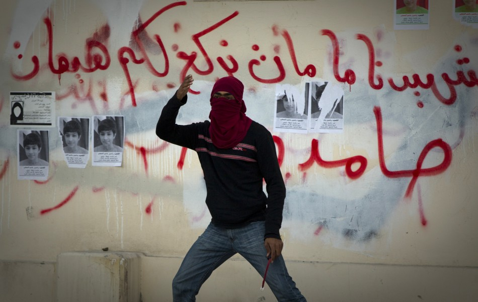 A protester gestures during a standoff with police after a mourning procession