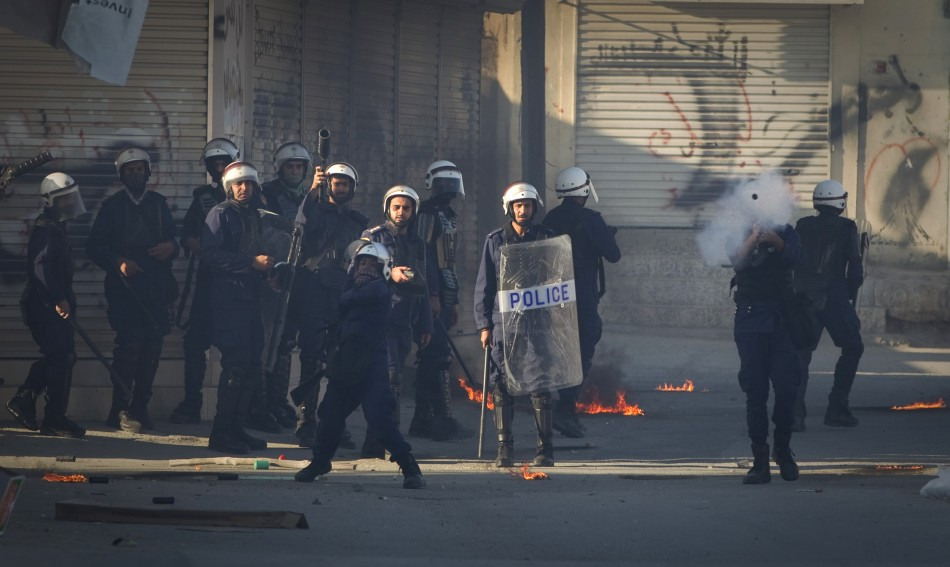 Police fire tear gas during a standoff with protesters after a mourning procession on the third day after the death of Yassin Al-Afsoor in the village of Mameer
