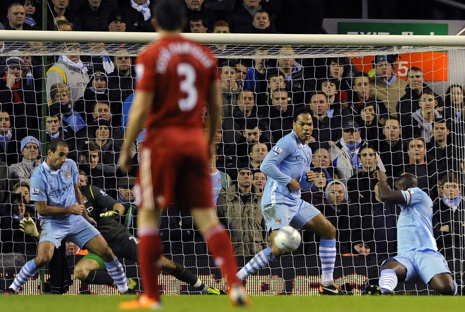 Manchester City's Richards handles the ball to award a penalty to Liverpool during their English League Cup semi-final soccer match at Anfield in Liverpool