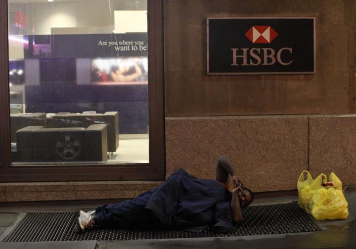 Homeless man outside a bank