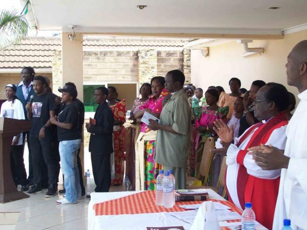 Bishop Christopher Senyonjo (second right) at the service to remember Ugandan gay activist David Kato