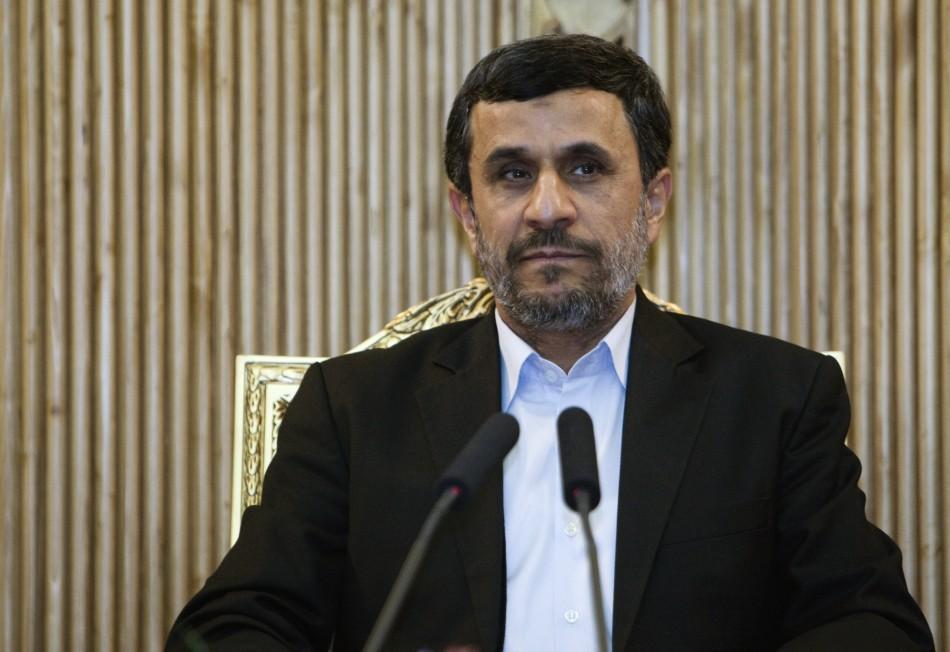 Iran's President Mahmoud Ahmadinejad speaks with journalists