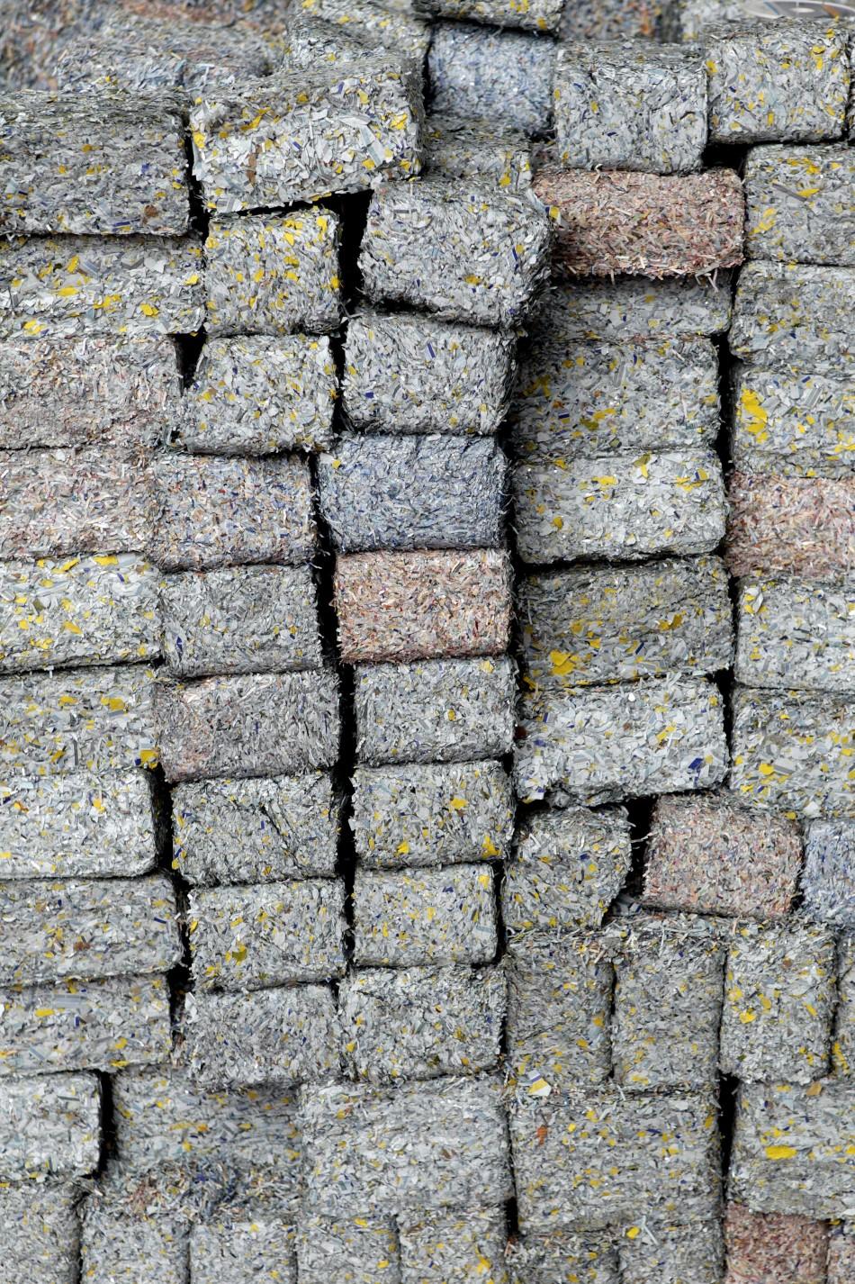 Bricks of shredded money are stacked in the 1.4 billion home.