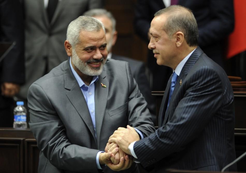 Turkey's Prime Minister Recep Tayyip Erdogan and Hamas' Gaza leader Ismail Haniyeh shake hands