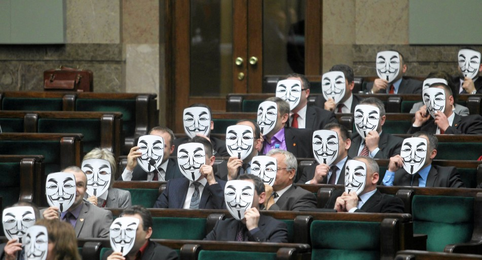 Members of Ruch Palikota Party wear masks