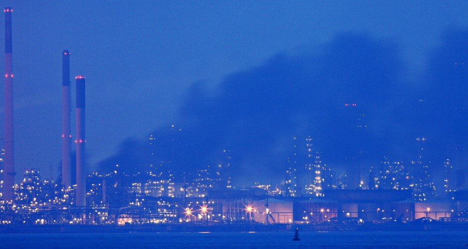 7. Royal Dutch Shell (RDS), Netherlands (Smoke billows from Royal Dutch Shell's Pulau Bukom offshore petroleum complex in Singapore at dusk September 29, 2011)