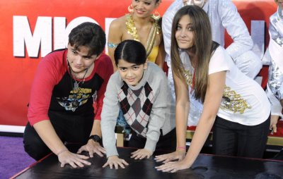 Michael Jacksons children Prince, Blanket and Paris use Jacksons shoes and gloves to make hand and foot imprints in cement in the courtyard of Hollywoods Graumans Chinese Theatre in Los Angeles