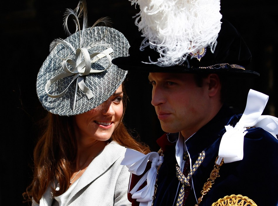 Britain039s Catherine, Duchess of Cambridge L, sits next to her husband Prince William as they leave the Order of the Garter service at St. George039s chapel inside the grounds of Windsor Castle, in Windsor, southern England