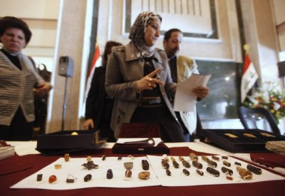 An employee checks recovered artefacts at the Iraqi Ministry of foreign Affairs headquarters in Baghdad
