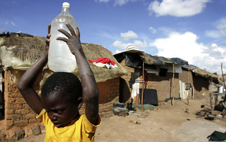 A boy carries a container of water in the suburb of Epworth in Zimbabwe's capital, Harare