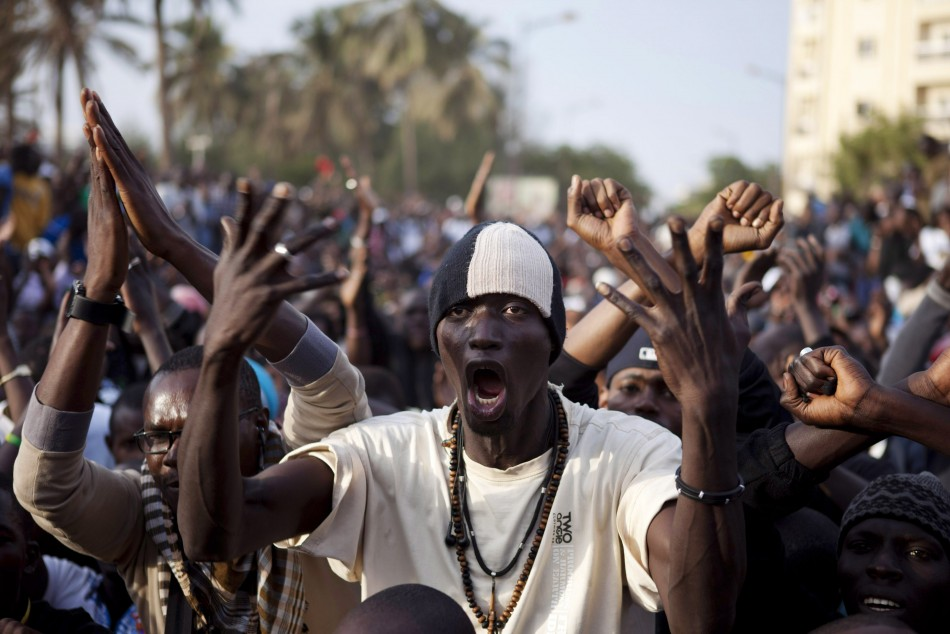 Anti-government demonstrators take to the streets during a protest against Senegal's President Abdoulaye Wade