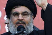 Hezbollah leader Sheikh Sayyed Hassan Nasrallah greets supporters in Beirut