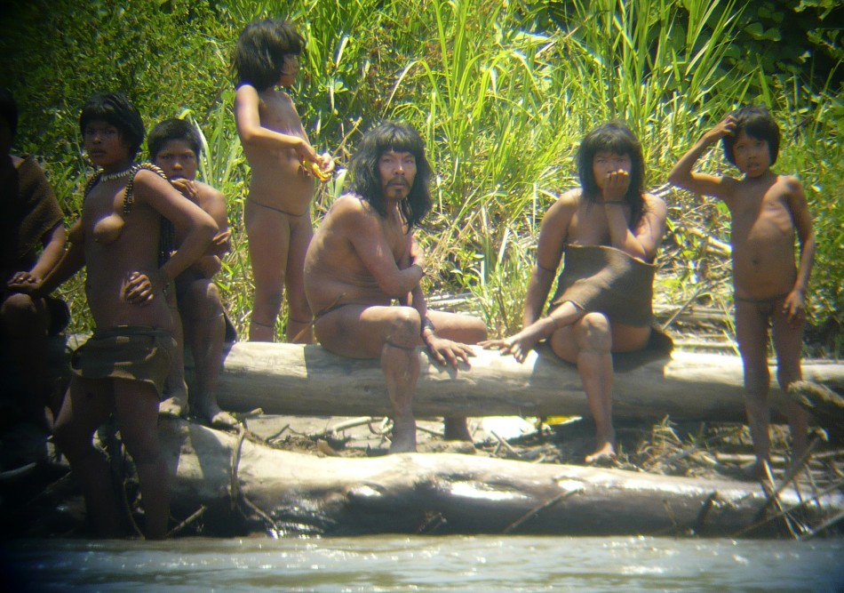 pictures of a family of the Mashco-Piro tribe in the Amazonian South-east Peru.
