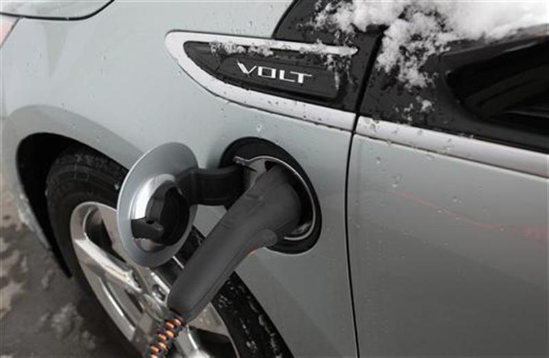 A Chevy Volt hybrid-electric car charging in Australia.