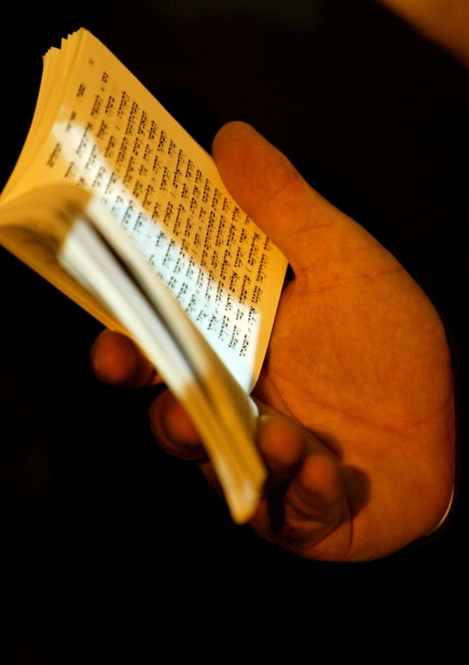 An ultra orthodox Jew holds a Torah book