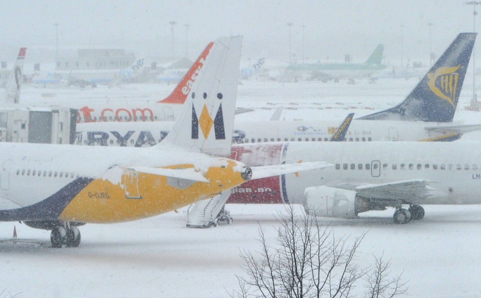 Planes sit on tarmac at Gatwick Airport during heavy snowfall in December 2010