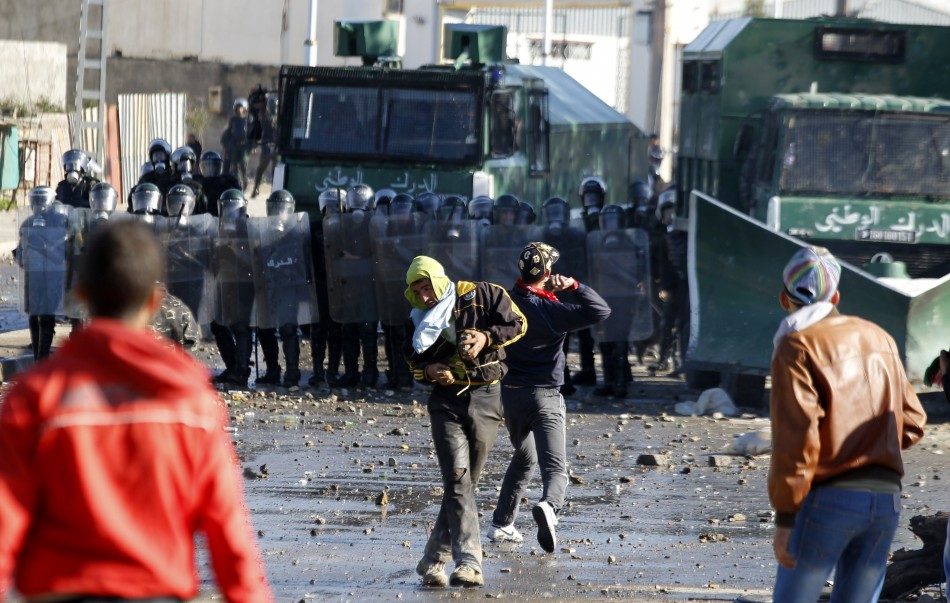 Protester throw stones at riot gendarmerie during clashes in Cheraga, on the outskirts of Algiers
