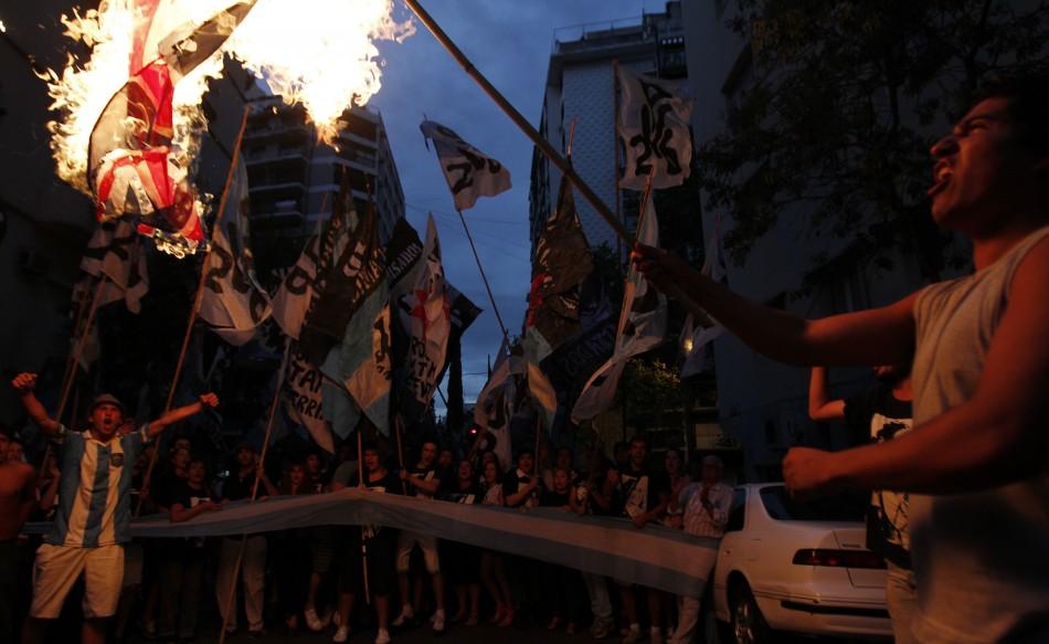 Demonstrators burn a British flag outside the British embassy