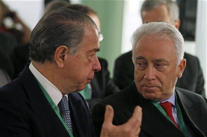 ECB governing council member Costa listens to Portuguese bank BES CEO Salgado before a financial conference in Lisbon