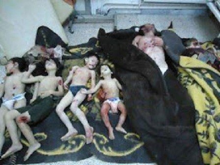 Bodies of a family whom activists say were killed by the Syrian government army, are seen at a medical centre in Karm al-Zeitoun near Homs