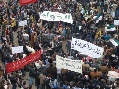 Demonstrators protest against Syrias President Bashar al-Assad in Hula, near Homs