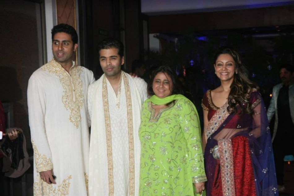 Bollywood actor Abhishek Bacachan, director Karan Johar and Gauri Khan at Retiesh Deshmukh and Genelia D'Souza's wedding in Mumbai, India.